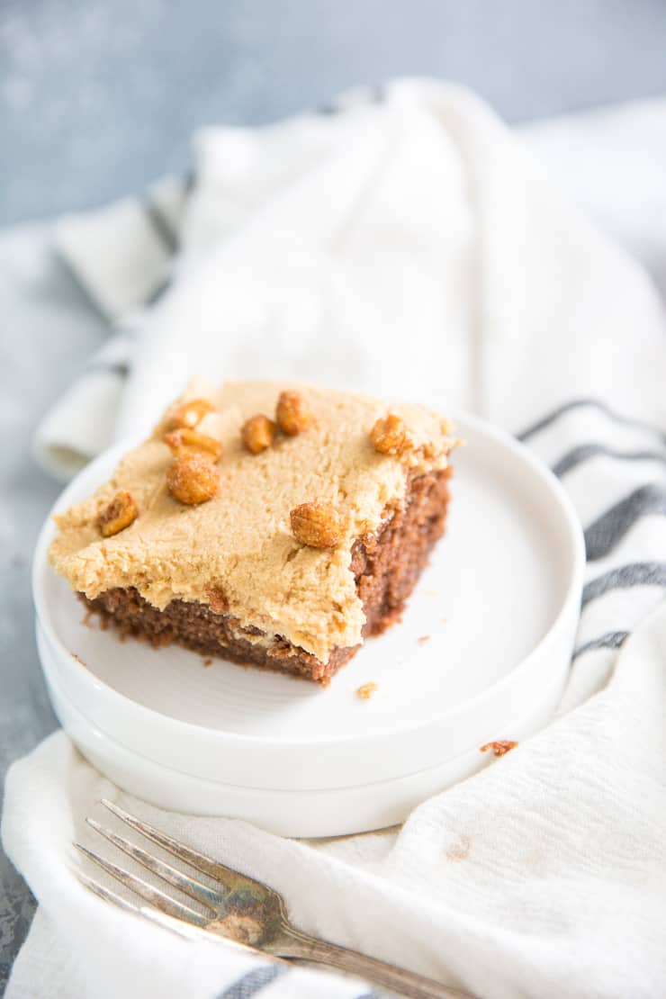 a piece of peanuts and coke cake on a white plate