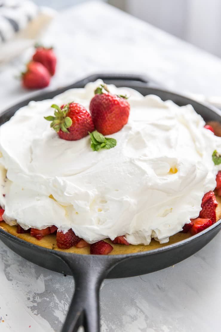 strawberry shortcake cake in a cast iron skillet