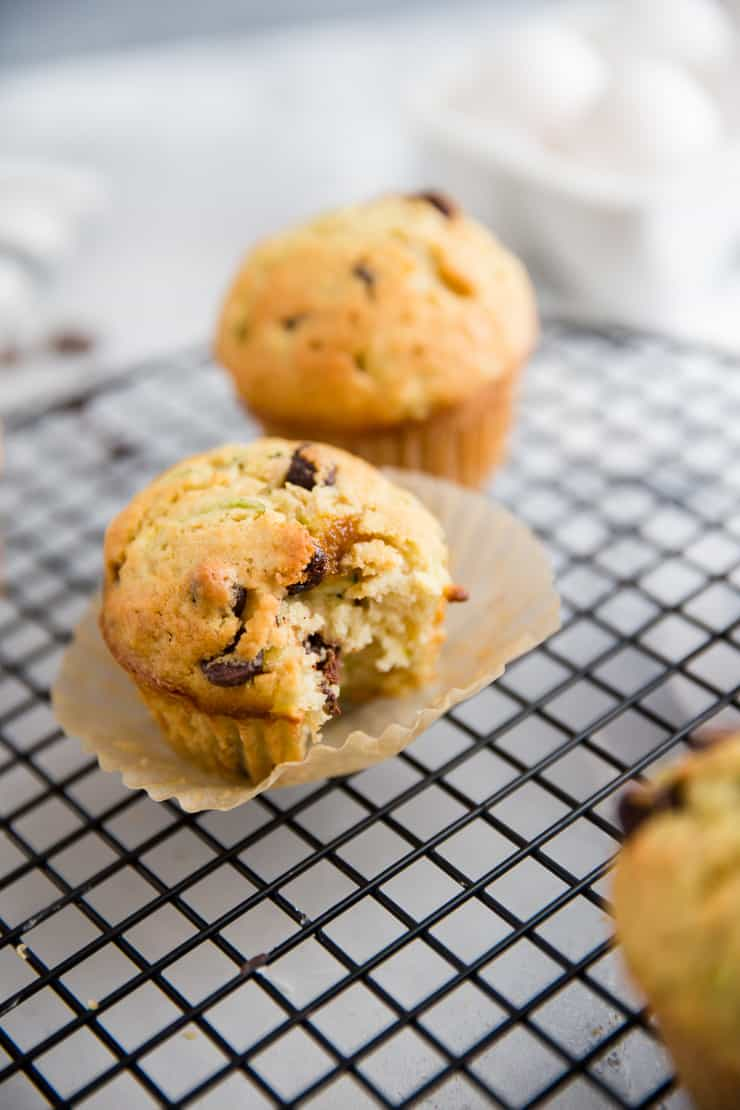 a zucchini muffin with a bite taken out