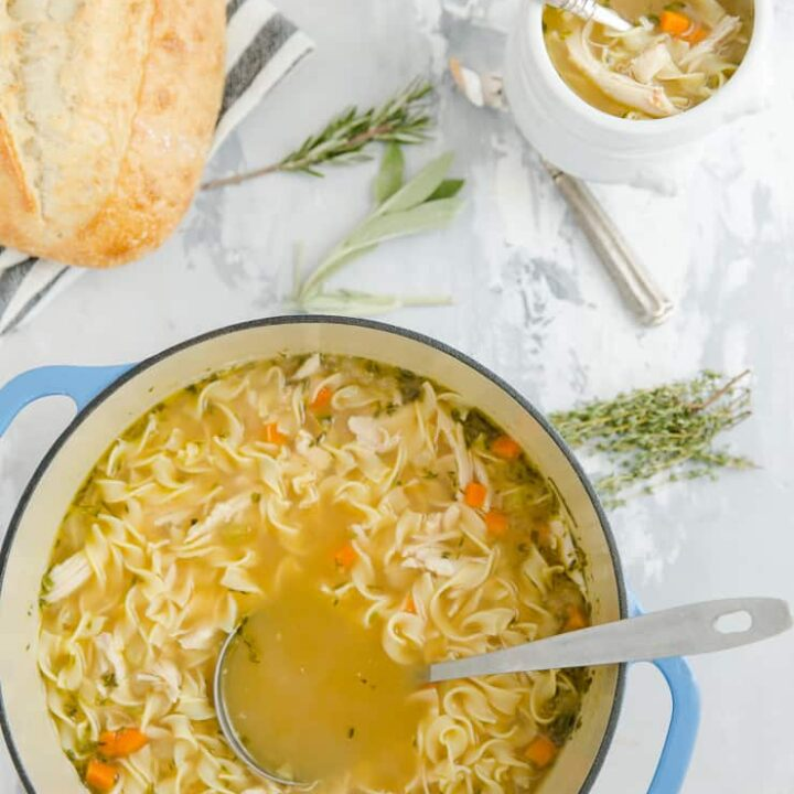 pot of soup with a bowl of soup on the side