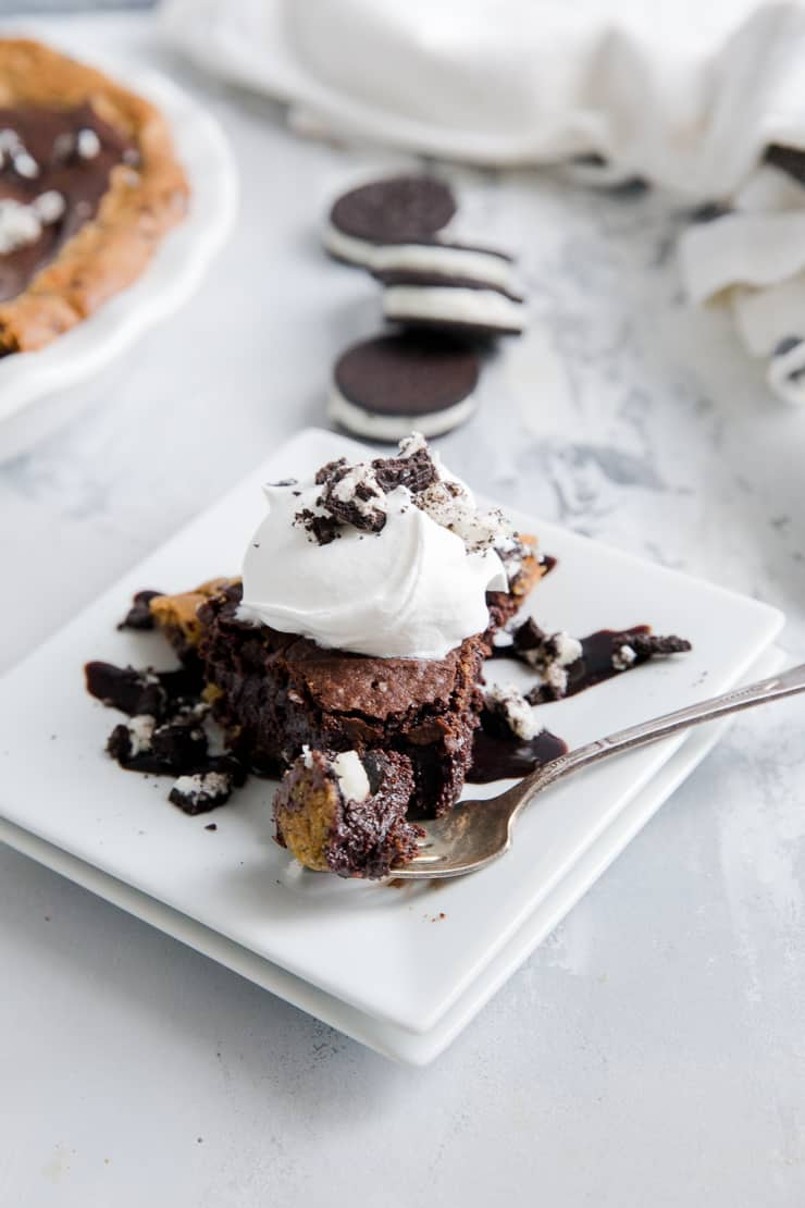slutty brownie with a fork taking a bite out
