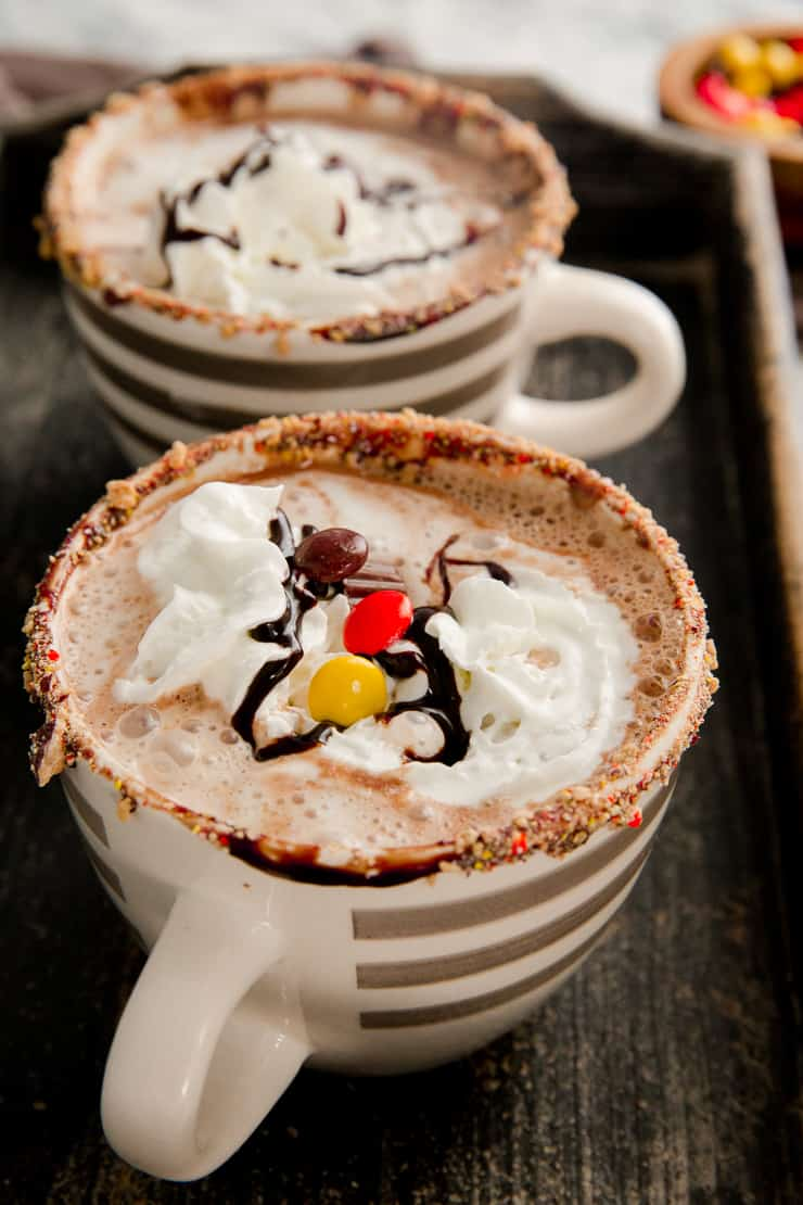 hot chocolate with whipped cream and candy pieces