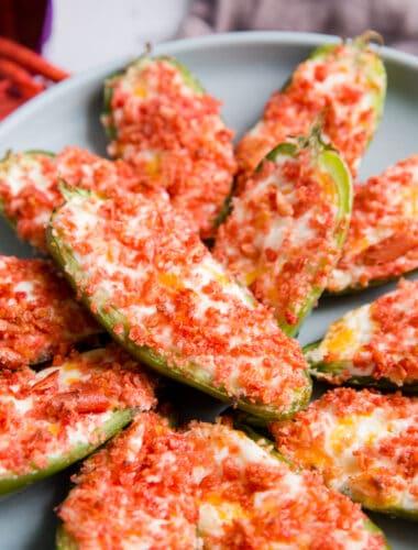 stuffed jalapenos on a plate