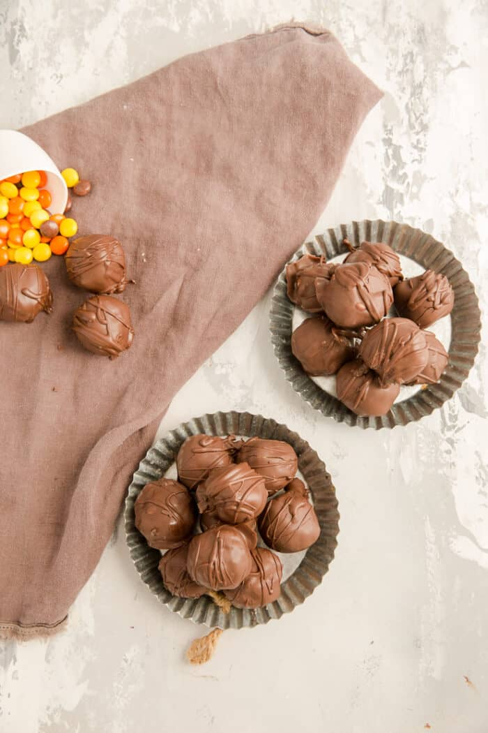 peanut butter balls on two silver plates