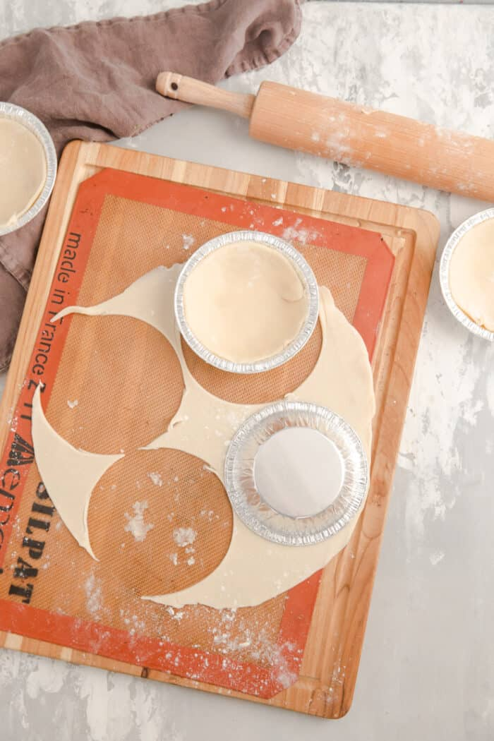pie dough in the tins