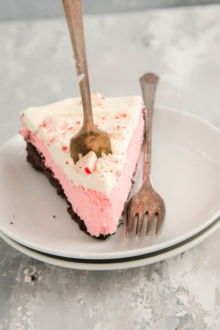 a slice of cheesecake with a fork it in