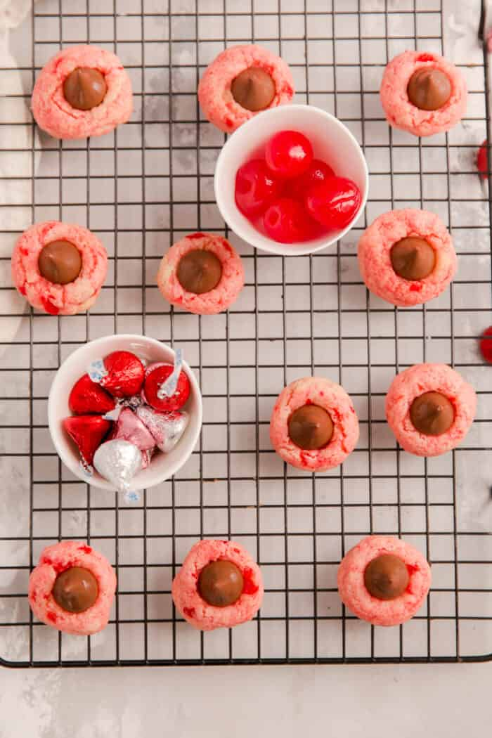cherry thumbprint cookies with a bowl of cherries