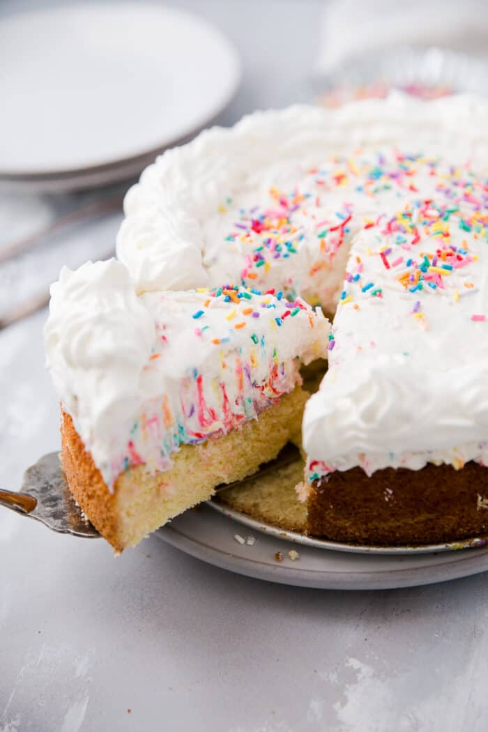 slice of funfetti cake being served