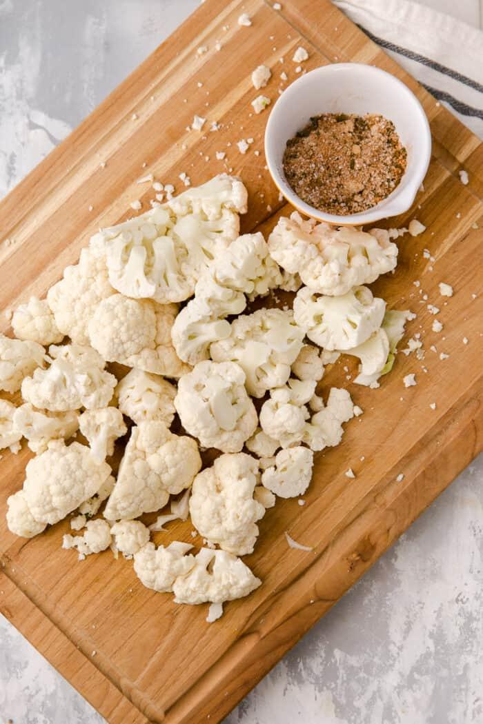 cauliflower florets on a cutting board