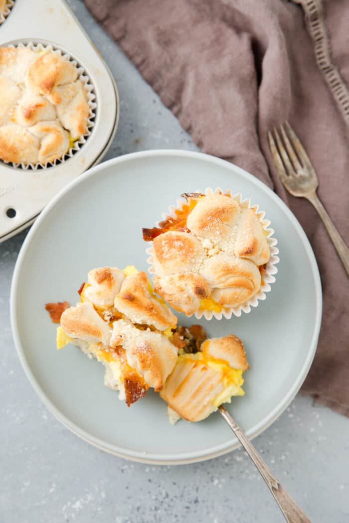 monkey bread muffins on a plate with with a fork