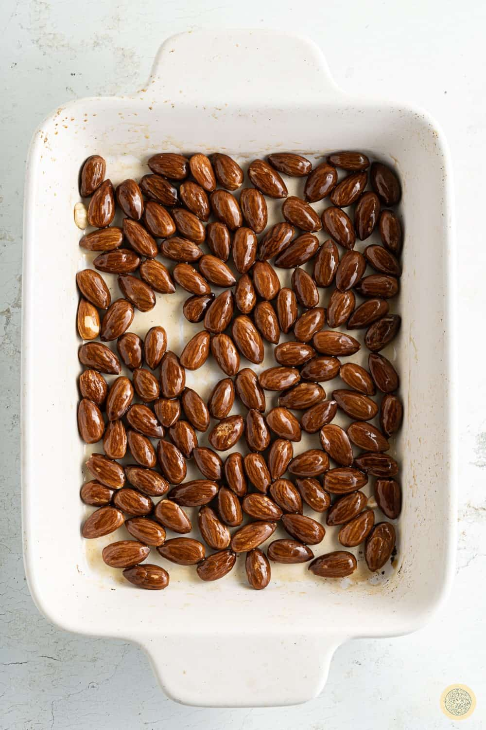 place the almonds with a drizzle of olive oil and bake them for 10-12 minutes